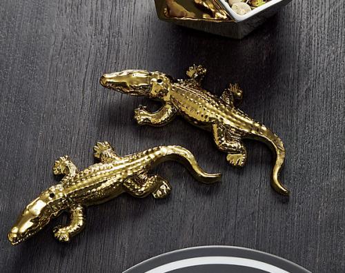 Two piece gold alligator salt and pepper set
